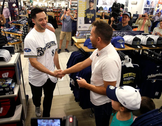 Ryan Braun greets Kevin Oelke and his family Wednesday at Kohl's in Menomonee Falls. The family received a gift card to purchase Brewers fan gear for the National League Division Series.