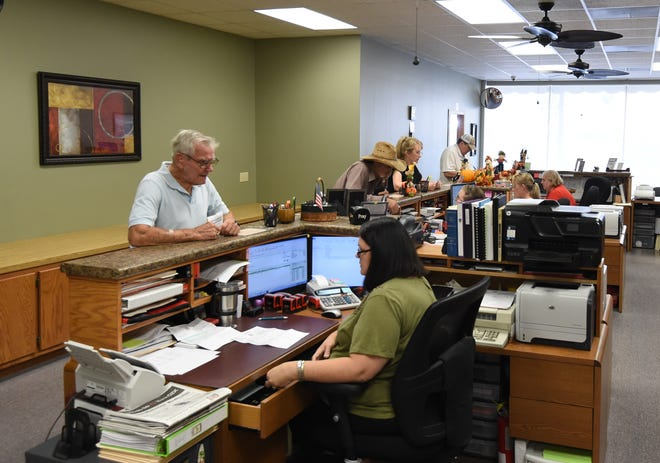 Baxter County residents pay their 2017 property taxes on Wednesday afternoon at the Baxter County Tax Collector's Office. Property taxes are due statewide on Monday, Oct. 15.