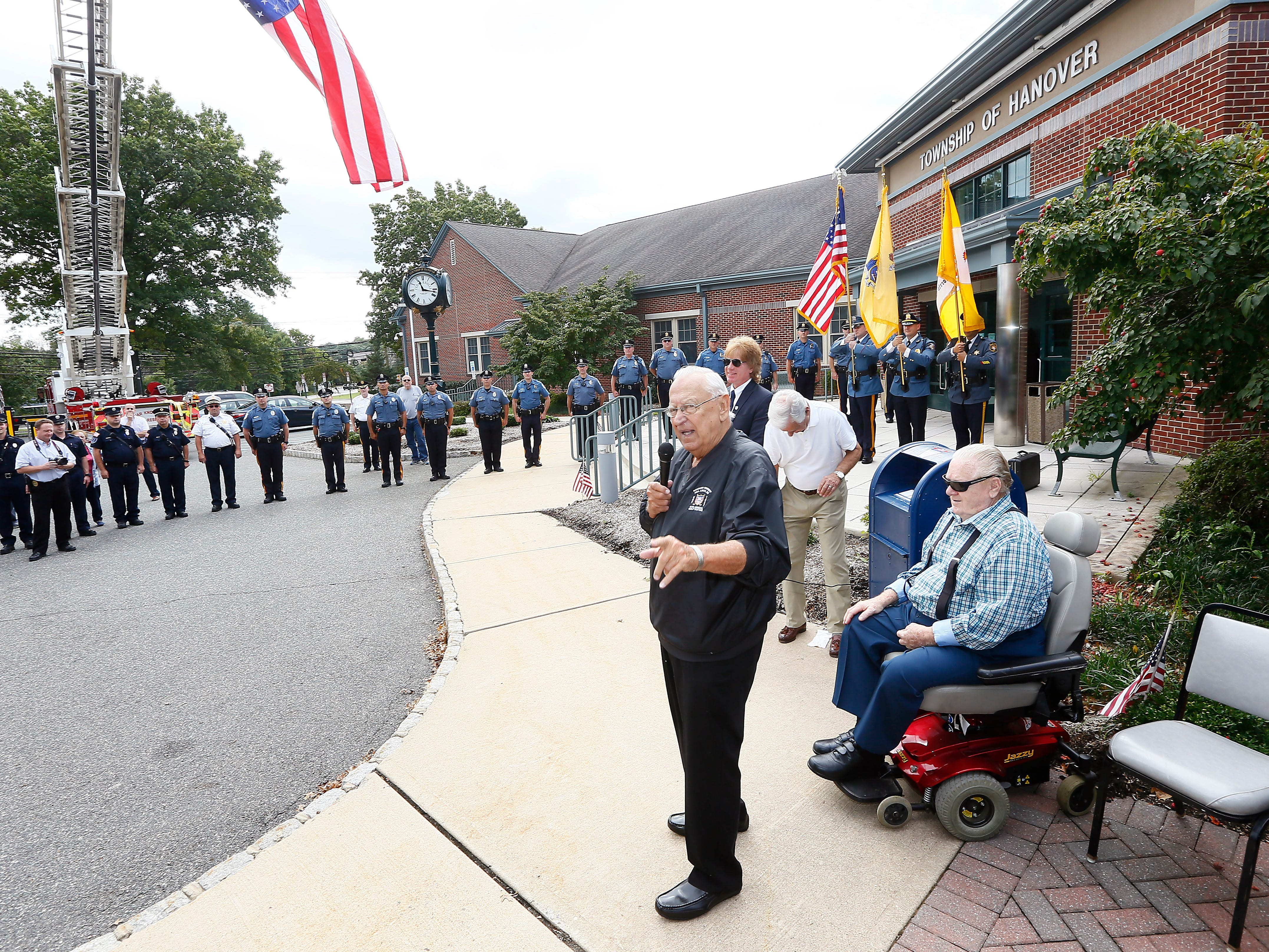 Steve Bolcar speaks to the crowd during the police-style clapout for the retirement of the 60-year officer and crossing guard at the Hanover Municipal Building. October 3, 2018, Hanover, NJ