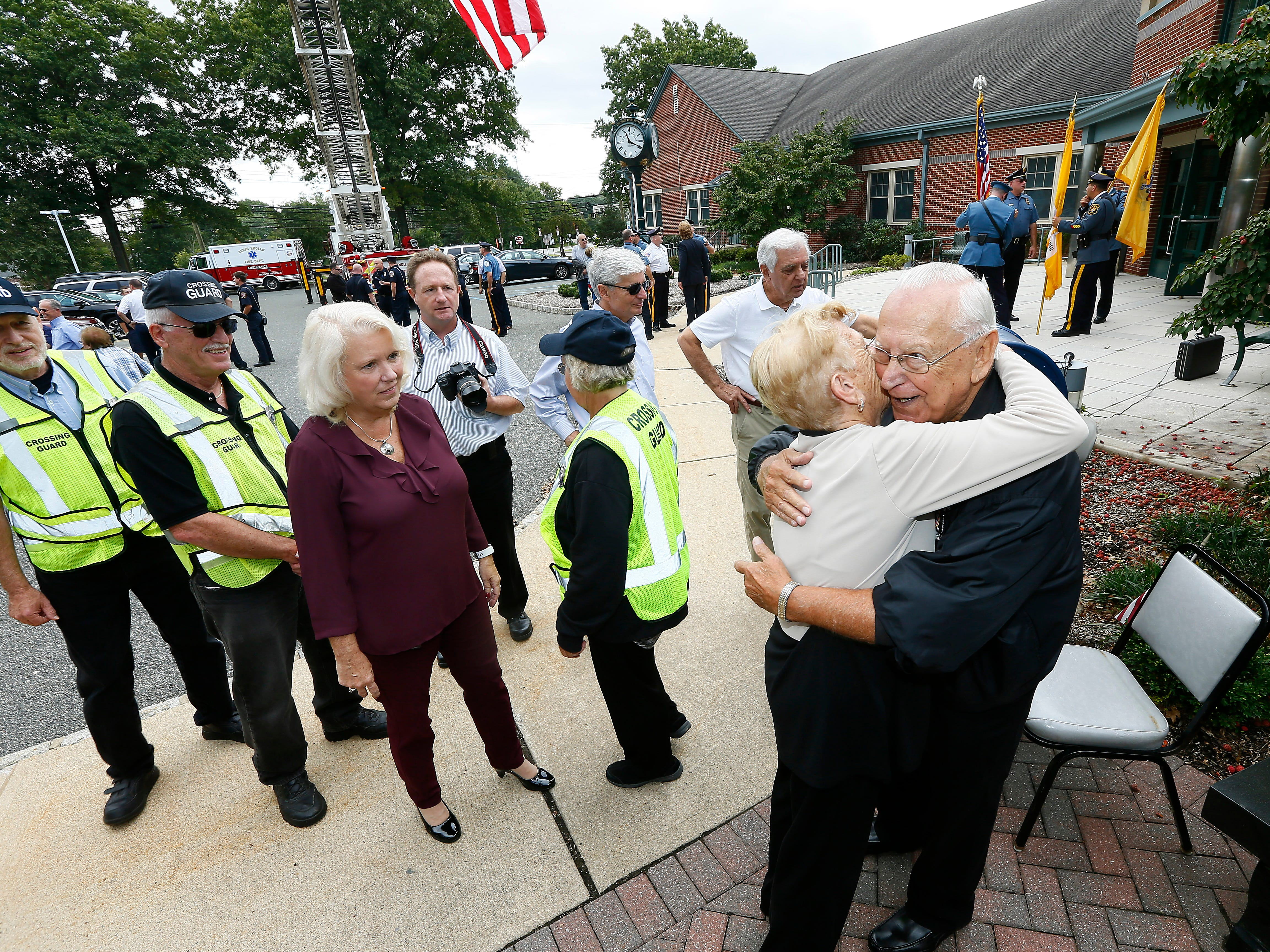Steve Bolcar hugs friends after speaking to the crowd during the police-style clapout for the retirement of the 60-year officer and crossing guard at the Hanover Municipal Building. October 3, 2018, Hanover, NJ