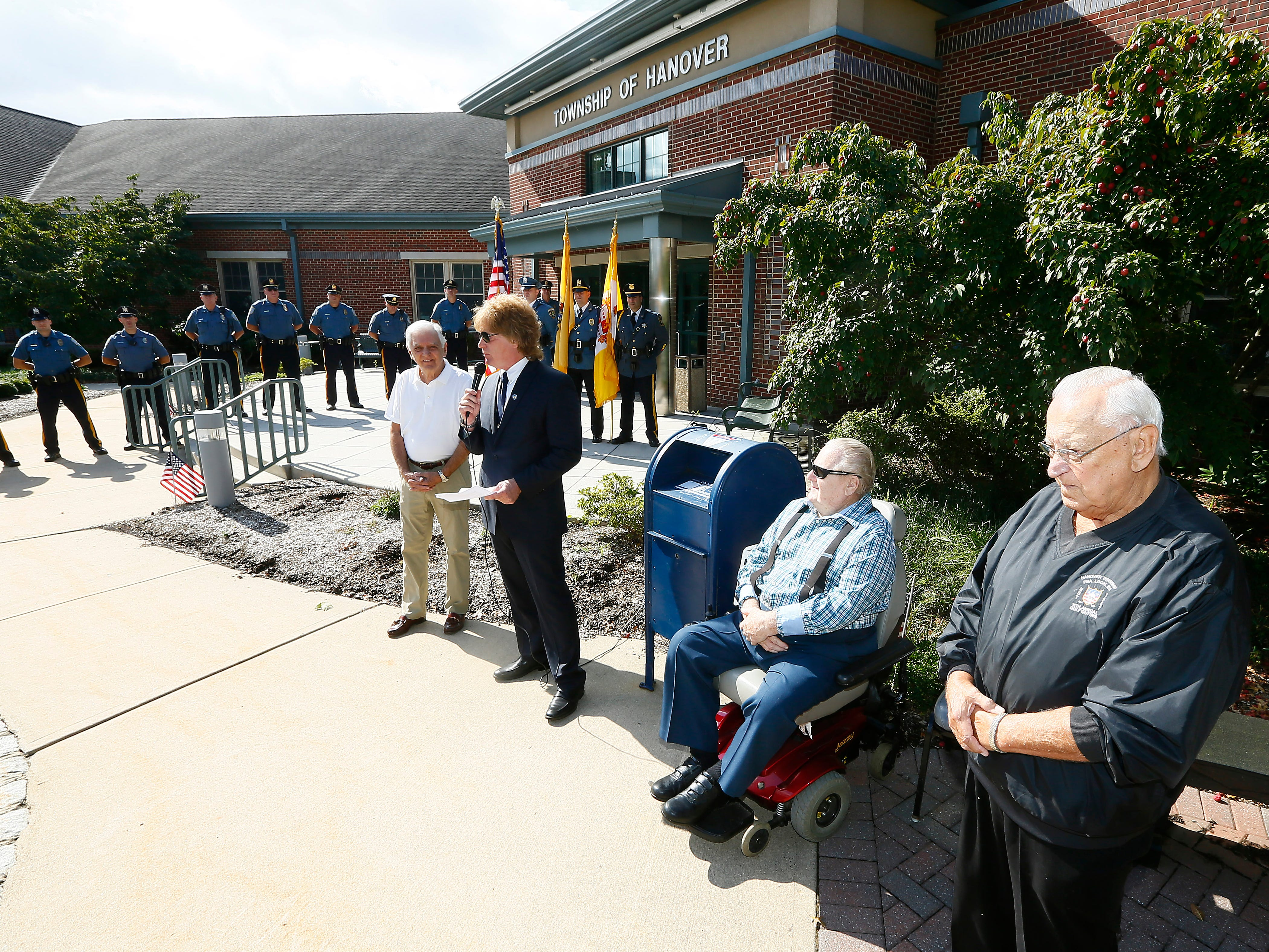 Ace Gallagher speaks at the Hanover Municipal Building during a police-style clapout for retirement of 60-year officer and crossing guard, Steve Bolcar. October 3, 2018, Hanover, NJ