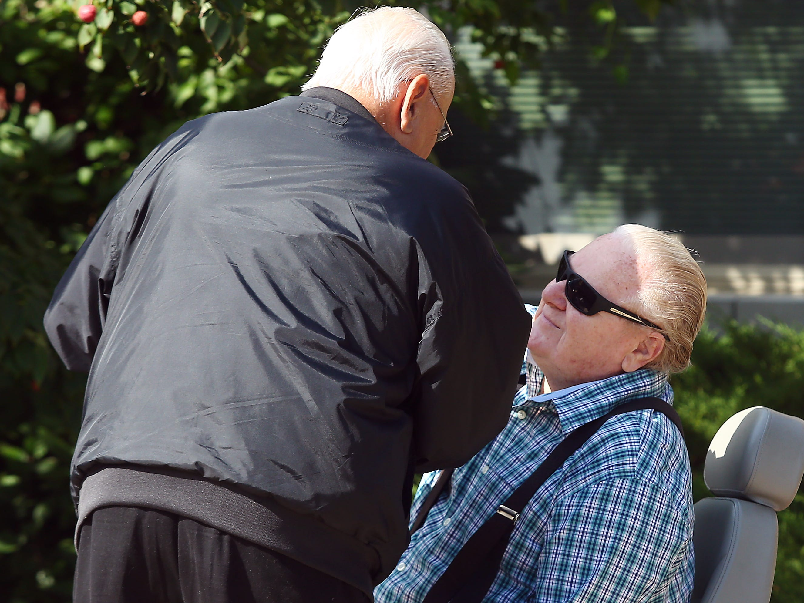 Steve Bolcar shakes hands with life-long friend Joseph Mihalko at the Hanover Municipal Building during his Police-style clapout for retirement of the 60-year officer and crossing guard. October 3, 2018, Hanover, NJ