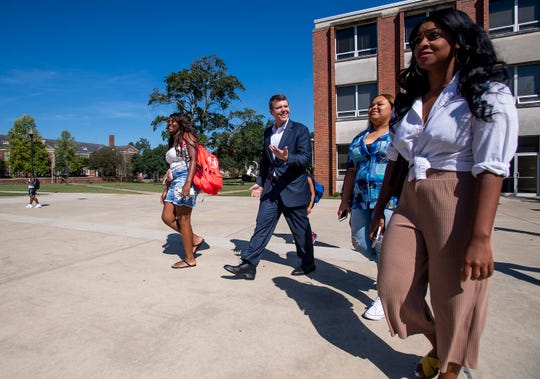 Democratic gubernatorial candidate Walt Maddox talks with students as he visits the Alabama State University campus in Montgomery, Ala., on Wednesday October 3, 2018.