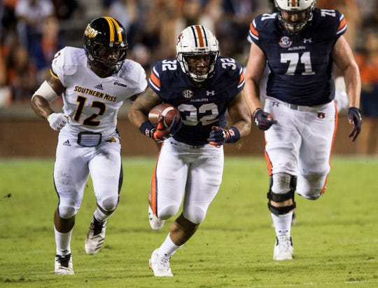 Auburn's Malik Miller (32) breaks a run against Southern Miss at Jordan-Hare Stadium in Auburn, Ala., on Saturday, Sept. 29, 2018. Auburn defeated  Southern Miss 24-13.
