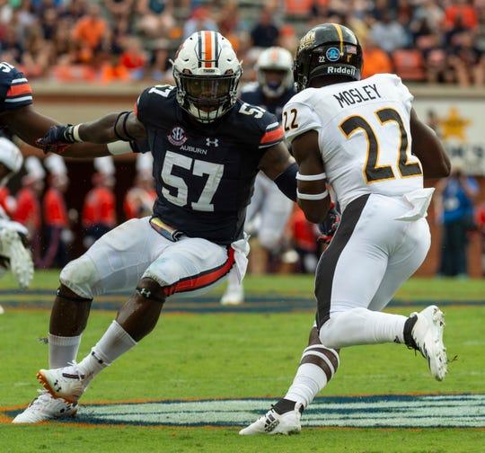 Auburn linebacker Deshaun Davis (57) tracks down Southern Miss running back Trivenskey Mosley (22) during the first half of an NCAA college football game, Saturday, Sept. 29, 2018, in Auburn, Ala.