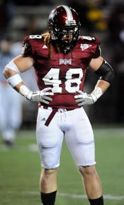Troy linebacker Bear Woods during more peaceful times with the Trojans.