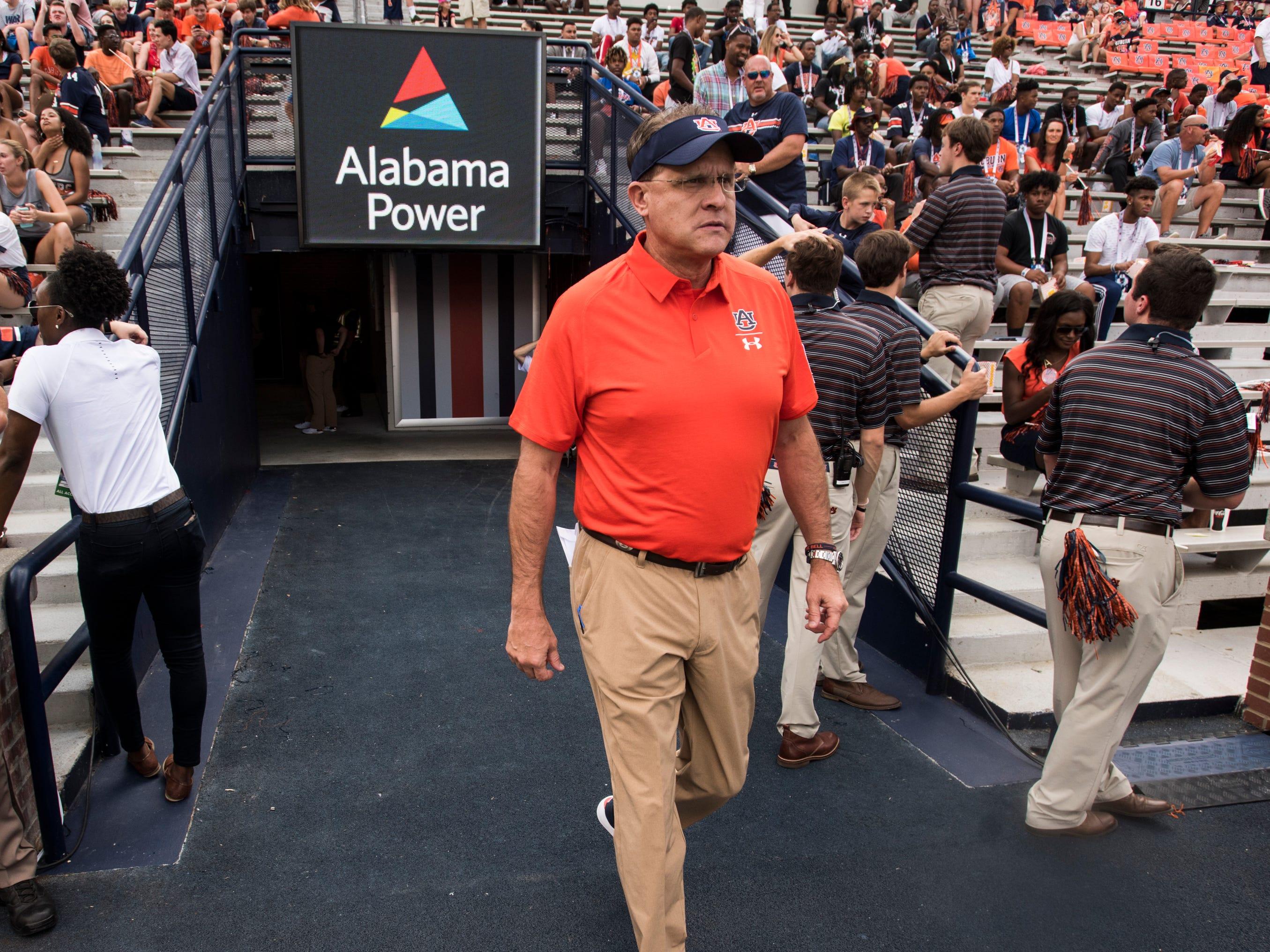 Auburn head coach Gus Malzahn takes the field for warm ups before his team takes on Southern Miss at Jordan-Hare Stadium in Auburn, Ala., on Saturday, Sept. 29, 2018. Auburn defeated  Southern Miss 24-13.