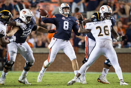 Auburn's Jarrett Stidham (8) throws the ball down the field at Jordan-Hare Stadium in Auburn, Ala., on Saturday, Sept. 29, 2018. Auburn defeated  Southern Miss 24-13.