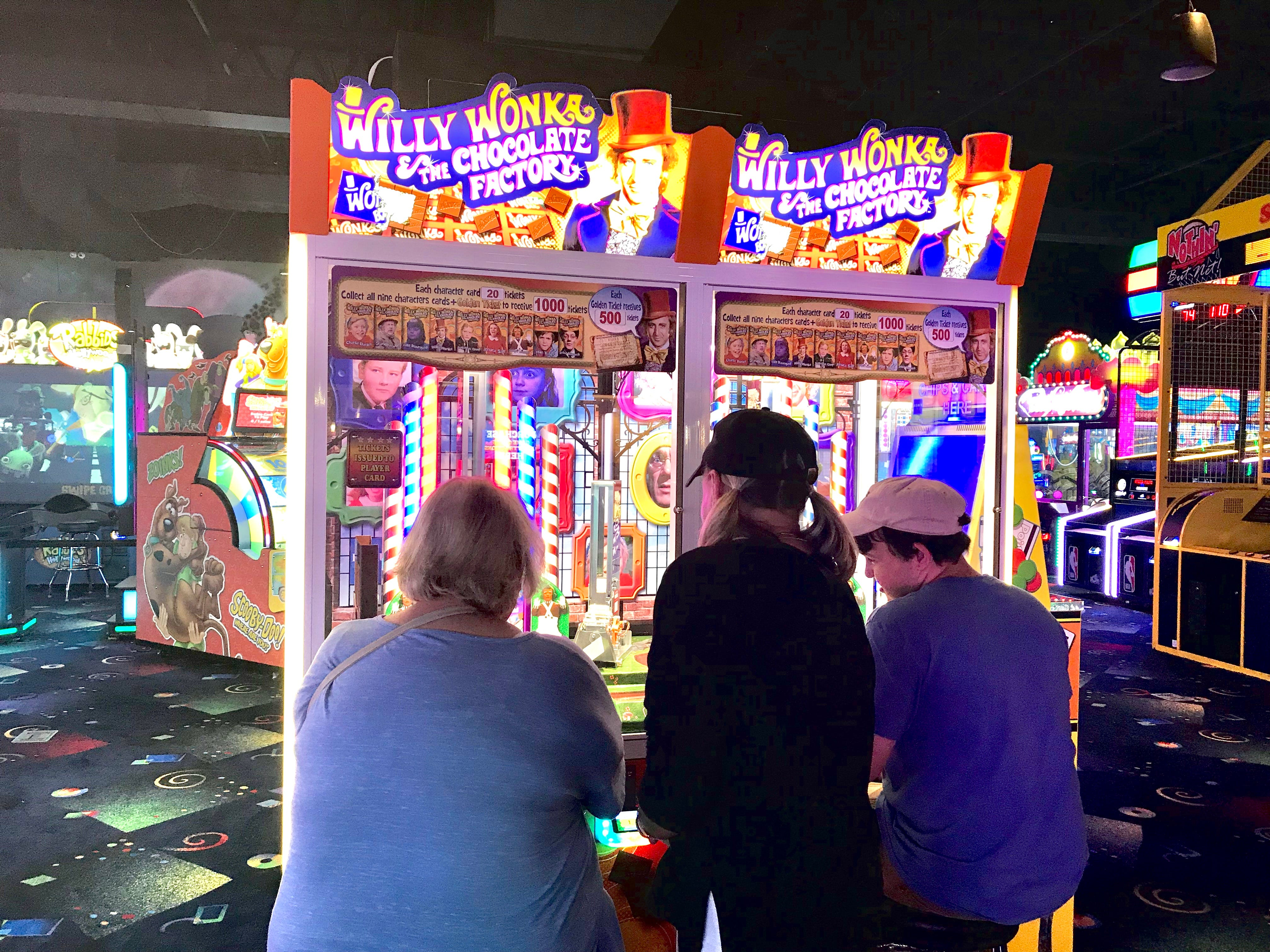 In this Wednesday, Oct. 3, 2018, photo, the England family plays a Willy Wonka game at Stars and Strikes in Smyrna, Tenn.