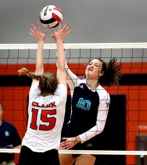 Siegel's Grace Reidmiller (10) hits the ball over the net as Stewarts Creek's Sam Clark (15) defends the net in the Dist 7-AAA volleyball tournament Championship held at Blackman, on Tuesday, Oct. 02, 2018. Siegel swept Creek in 3 sets.