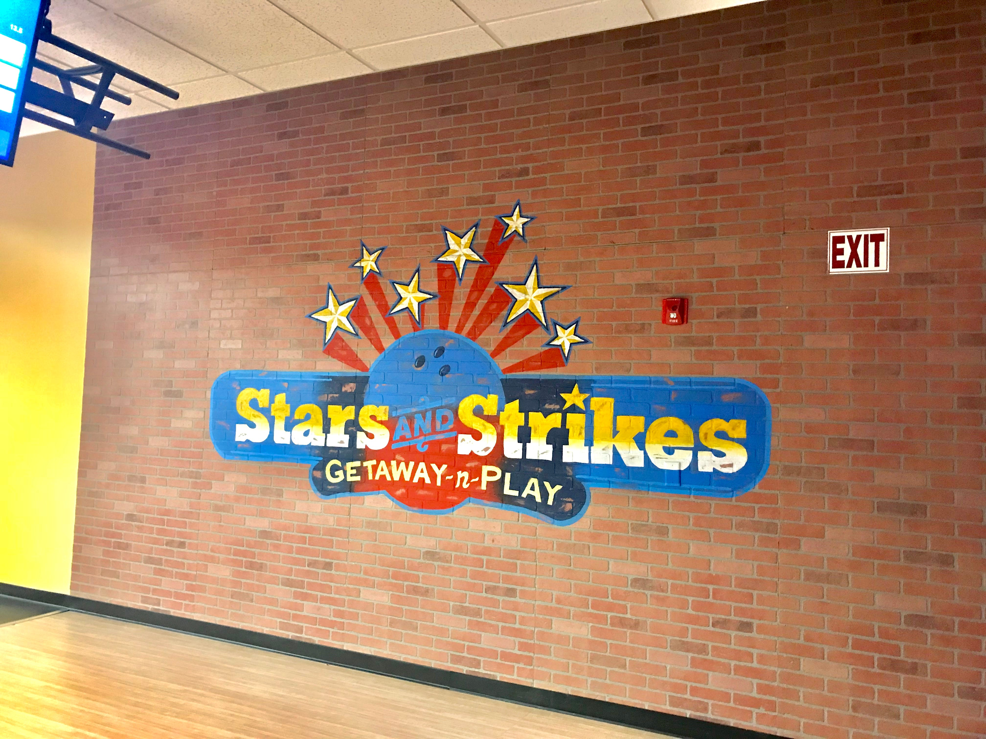 A mural painted on a brick wall at Stars and Strikes in Smyrna, Tenn.
