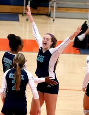 Siegel's Sophia Bossong (25) celebrates a point during a 2018 match.