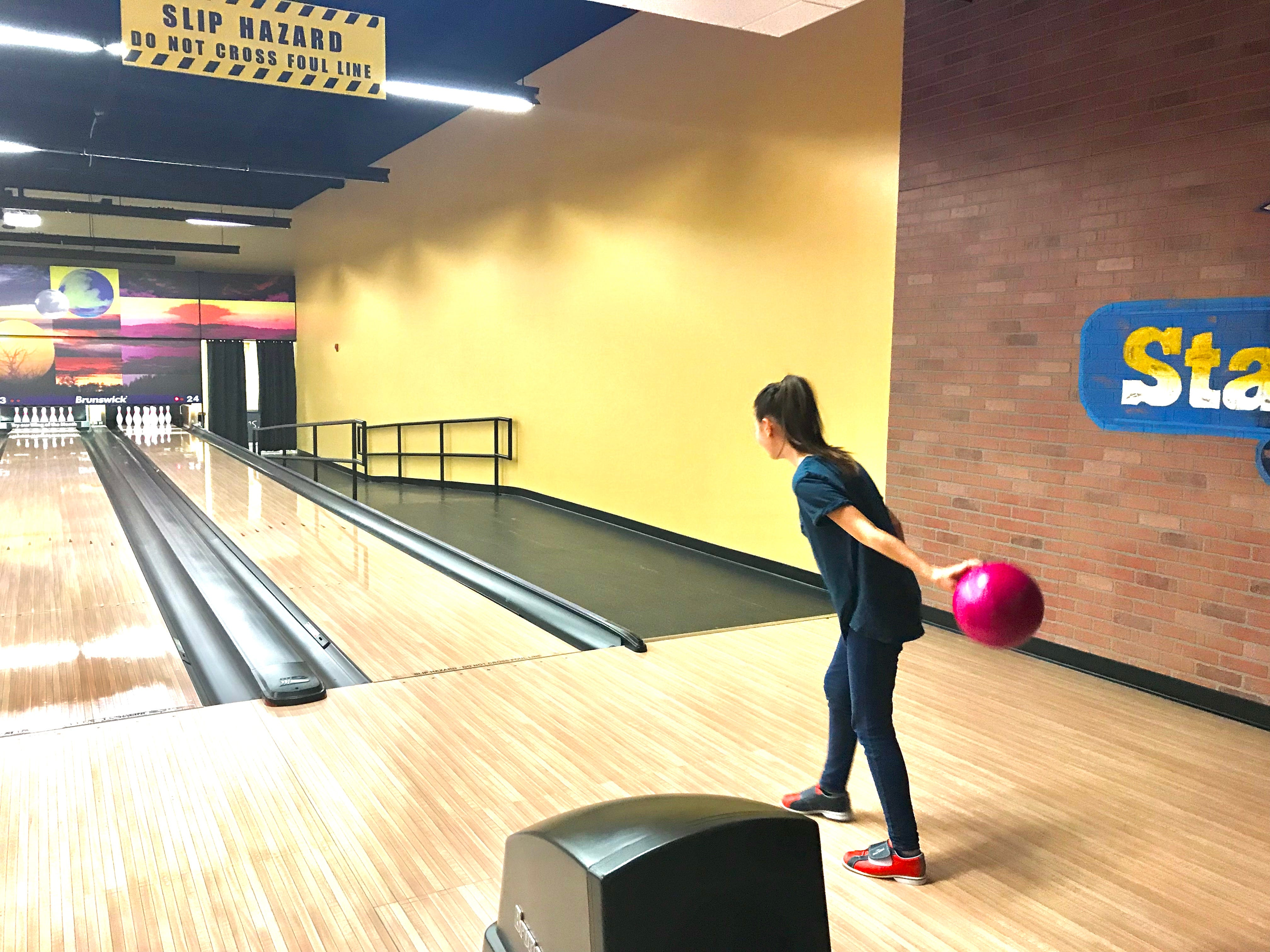 In this Wednesday, Oct. 3, 2018, photo, Reese Hamilton, 12, bowls a strike at Stars and Strikes in Smyrna, Tenn.