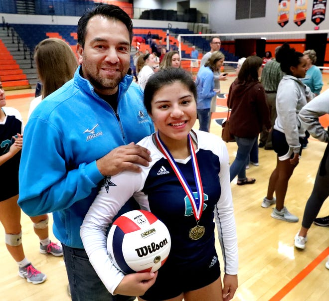 Providence Christian volleyball coach Chris Padilla poses with his daughter, Siegel sophomore June Padilla, following the Lady Stars' District 7-AAA championship win over Stewarts Creek Tuesday. Chris Padilla is a single father of three while juggling being a coach.