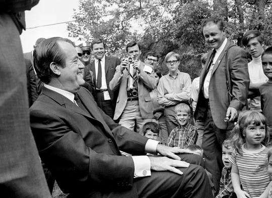 "Just before reaching WSM-TV for a taping of the ""Noon Show,"" Vice President and Democratic presidential candidate Hubert H. Humphrey, left, made an unscheduled stop to talk with about 50 pre-school children at the West Nashville Kindergarten Oct. 1, 1968."