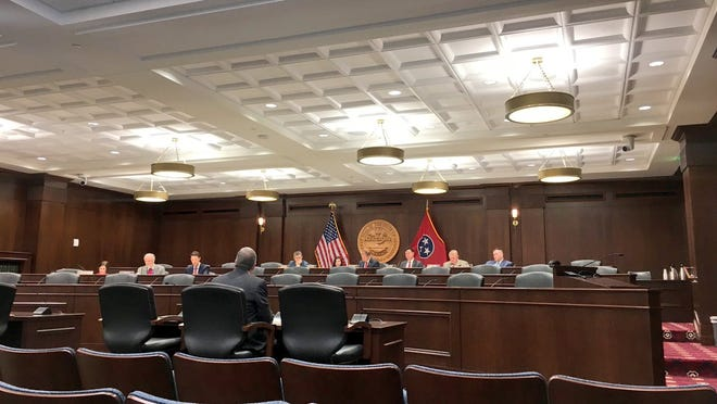 Chief Justice Jeff Bivins speaks to members of the House Criminal Justice Committee on October 2.