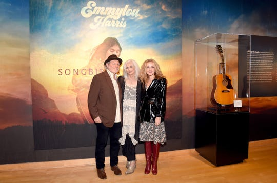 NASHVILLE, TN - OCTOBER 02: (L-R) Buddy Miller, Emmylou Harris and Patty Griffin view Harris' new exhibit at Country Music Hall of Fame and Museum on October 2, 2018 in Nashville, Tennessee.