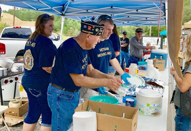 Post Commander Jim VanSickle works with fellow veterans at the American Legion Post 248 Fish Fry.