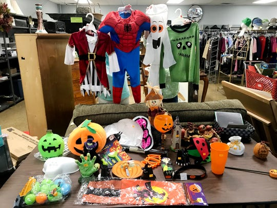 thrift stores are a great place to grab halloween costumes and decorations at a fraction of