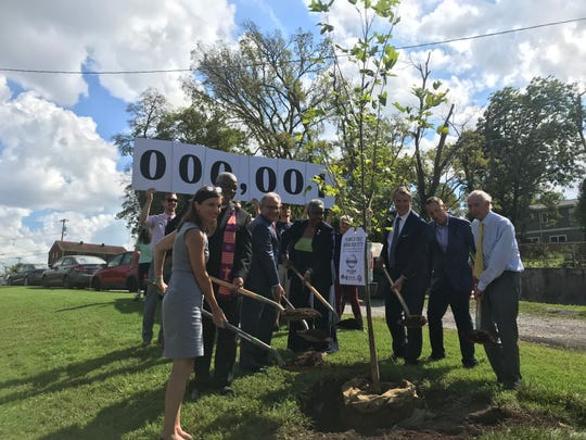 Mayor David Briley and others at a ceremonial tree-planting to kick off the Root Nashville campaign.