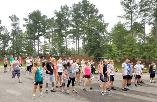Runners warm up prior to the start of the 2018 Donna Bledsoe 5K Memorial Race in Bowie Nature Park September 22, 2018.