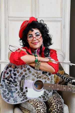 Country singer Kelly Lang was diagnosed with breast cancer more than a decade ago. When she was at her darkest and most afraid, she created the alter ego XOXO to lighten her mood and make others laugh. Thursday, Aug. 23, 2018, in Hendersonville, Tenn.