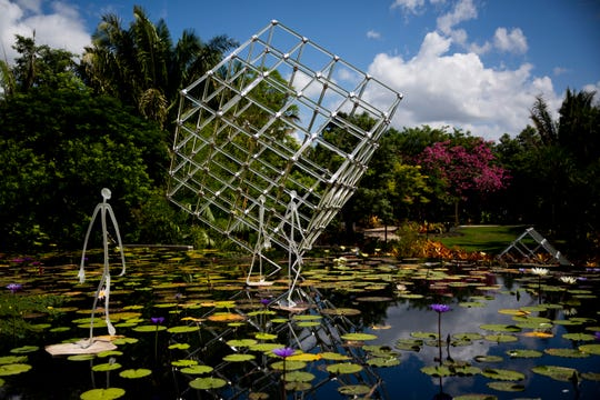 Hans Godo FrŠbel's glass art is displayed on Wednesday, October 3, 2018, at the Naples Botanical Garden in Naples. The exhibition opened on October 1, and will be up until March 31, 2019.
