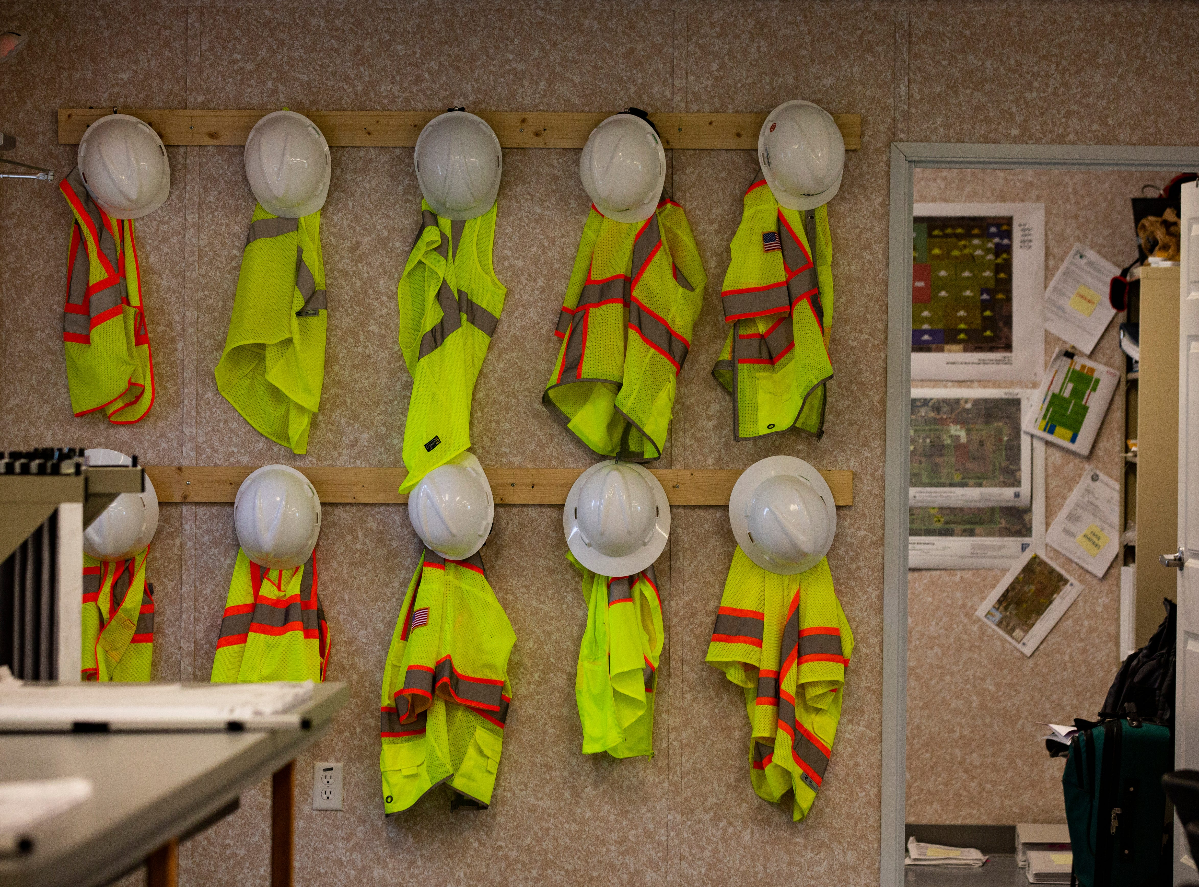 Neon vests and hard hats hang at the temporary work space of the Caloosahatchee Reservoir project in Hendry County. The project is also known as C-43 West Basin Storage Reservoir.