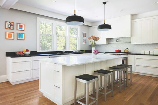 The kitchen features clean lines and neutral colors