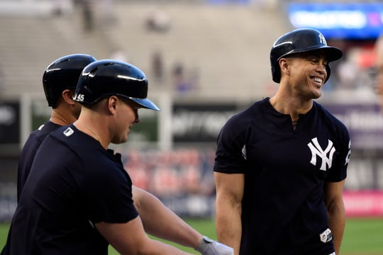 New York YankeesÕ Giancarlo Stanton, right, jokes around with teammates during batting practice. The Yankees face the Oakland Athletics in the American League Wildcard game on Wednesday, Oct. 3, 2018, in New York.