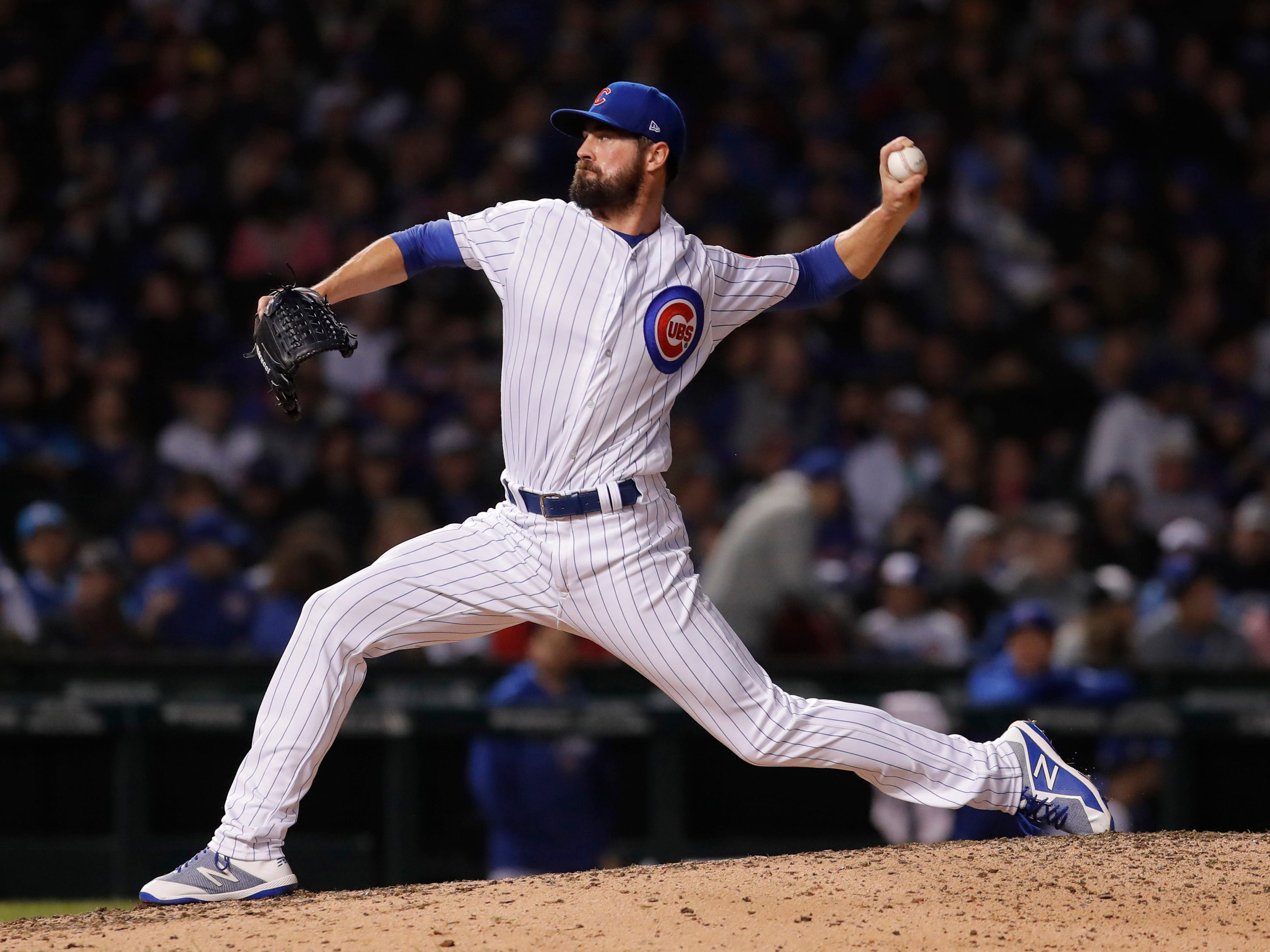 Oct 2, 2018; Chicago, IL, USA; Chicago Cubs pitcher Cole Hamels throws a pitch against the Colorado Rockies in the 10th inning in the 2018 National League wild card playoff baseball game at Wrigley Field.