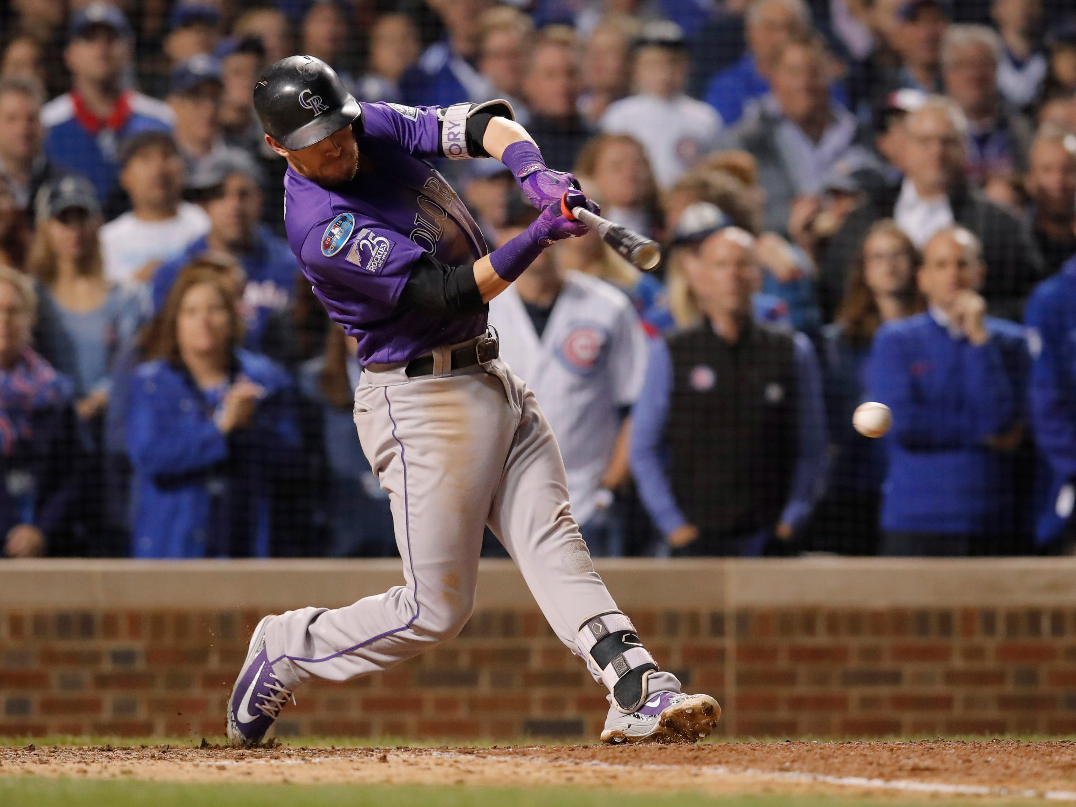 Oct 2, 2018; Chicago, IL, USA; Colorado Rockies shortstop Trevor Story hits a single in the 9th inning against the Chicago Cubs in the 2018 National League wild card playoff baseball game at Wrigley Field.