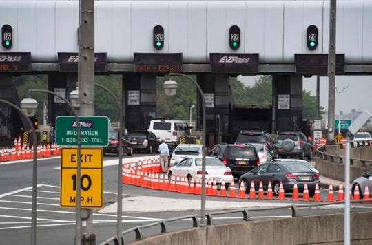 Sept. 12, 2013: A man gets out of his vehicle to see what's causing the backup at the toll plaza on the George Washington Bridge from the Bruce Reynolds Boulevard approach. Cars are getting backed up at the tolls because the approach has been narrowed to one tollbooth, seen on far right.