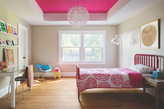 The daughter's bedding comes from Land of Nod line from Crate & Barrel; the inset ceiling shares the same bold pink color.