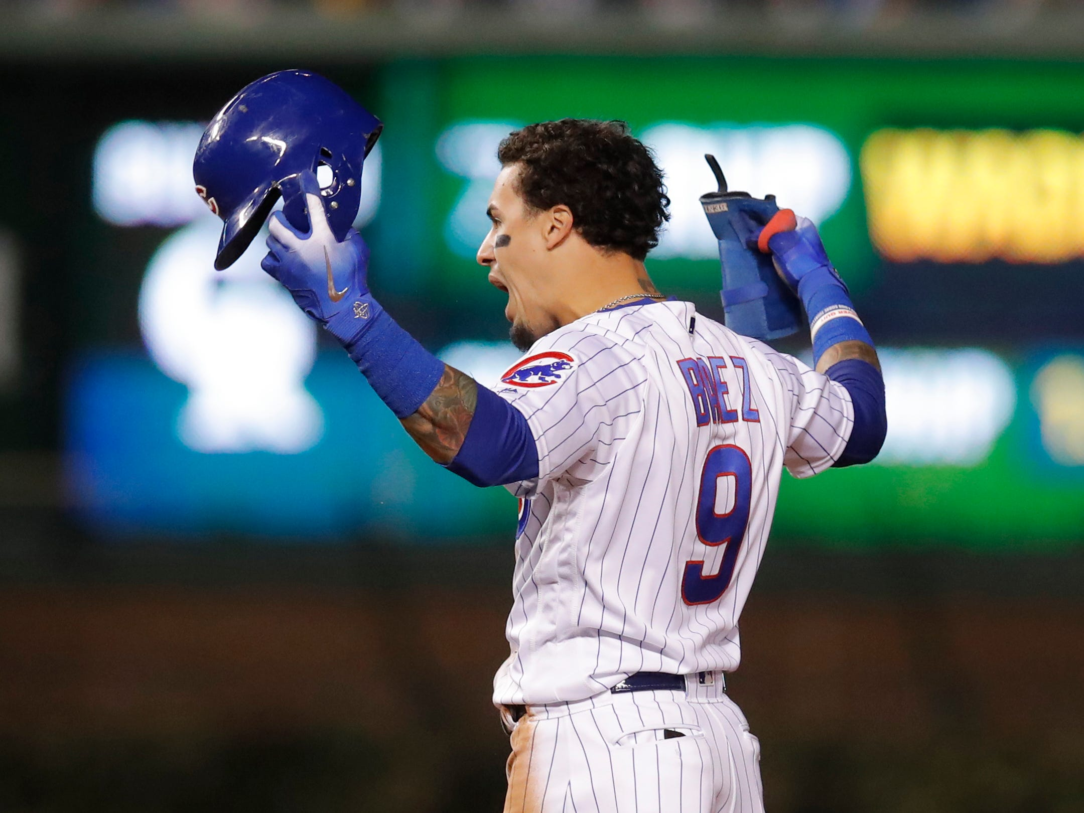 Oct 2, 2018; Chicago, IL, USA; Chicago Cubs shortstop Javier Baez (9) celebrates after hitting a RBI double against the Colorado Rockies in the 8th inning in the 2018 National League wild card playoff baseball game at Wrigley Field.