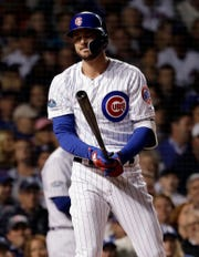 Chicago Cubs' Kris Bryant reacts after striking out on a foul tip during the first inning of the National League wild-card playoff baseball game against the Colorado Rockies, Tuesday, Oct. 2, 2018, in Chicago.