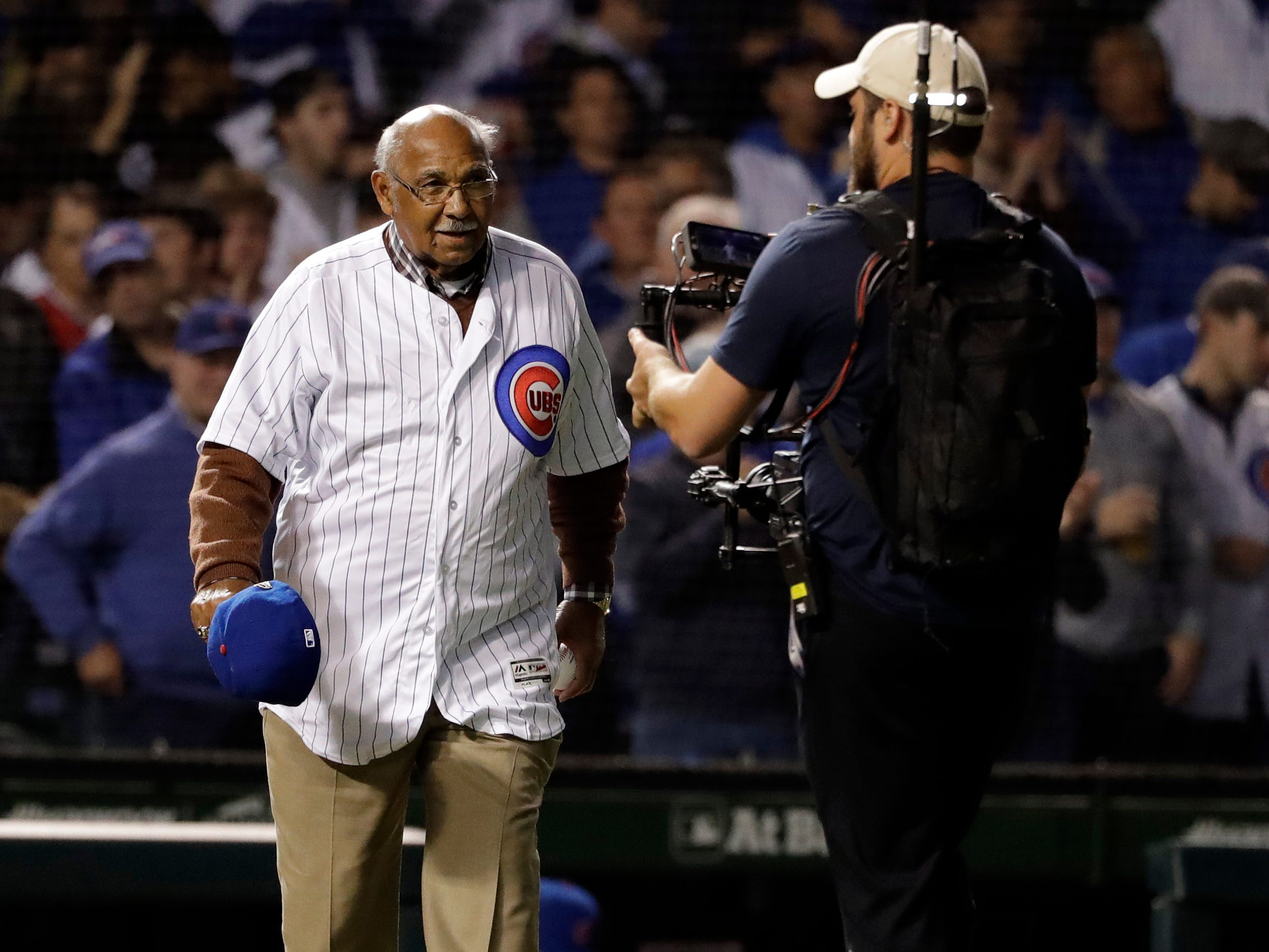 Former Chicago Cubs player Billy Williams walks on the field before throwing the ceremonial first pitch before the National League wild-card playoff baseball game between the Colorado Rockies and the Chicago Cubs, Tuesday, Oct. 2, 2018, in Chicago.