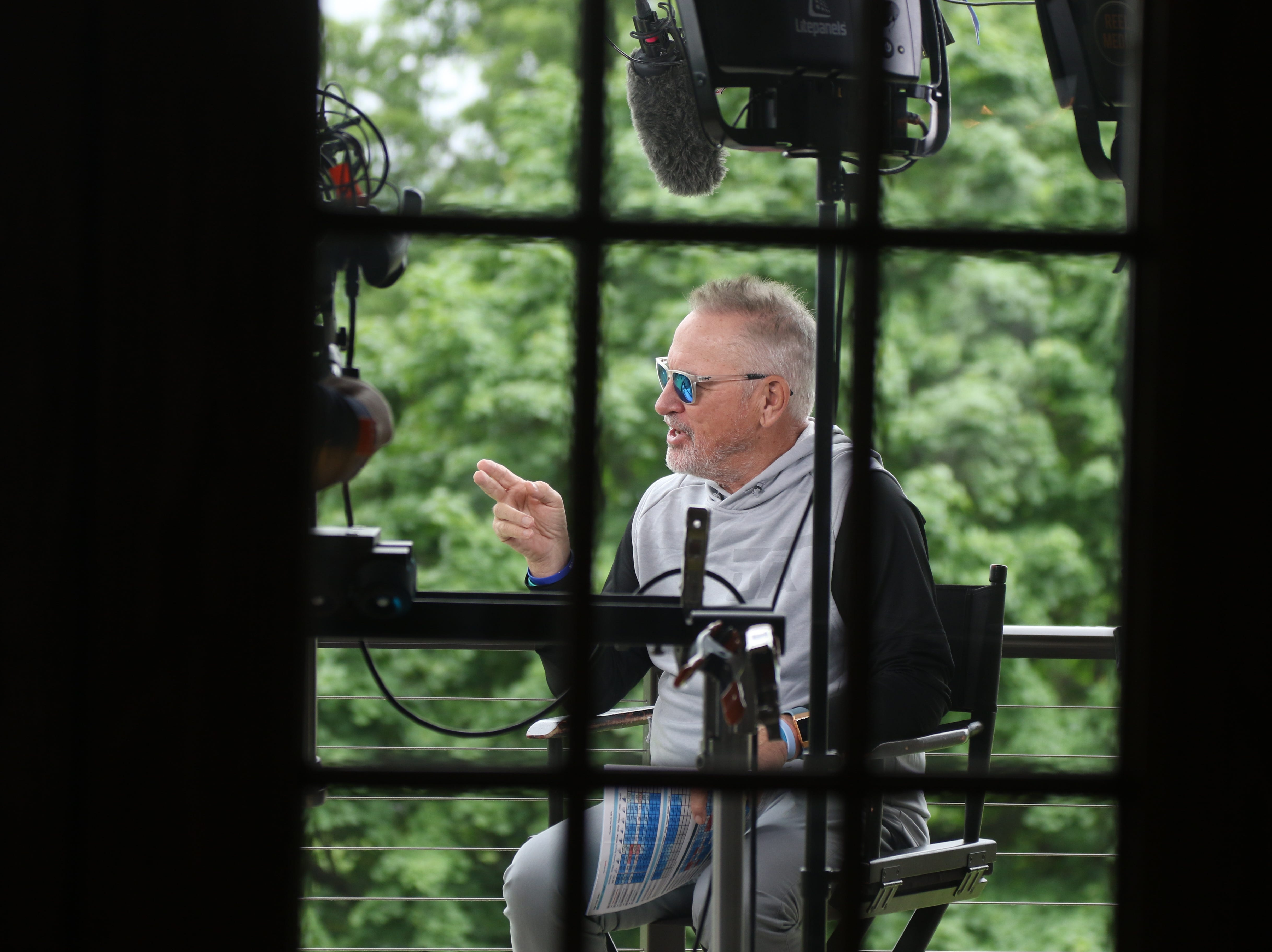Chicago Cubs manager Joe Maddon does an interview for the MLB network just before a golf outing at the Valley Country Club, to raise money for Maddon's program, the Hazleton Integration Project .