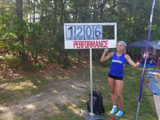 NV/Demarest pole vaulter Sydney Woods pointing to her winning height after winning Group 2 state title in early June 2018.