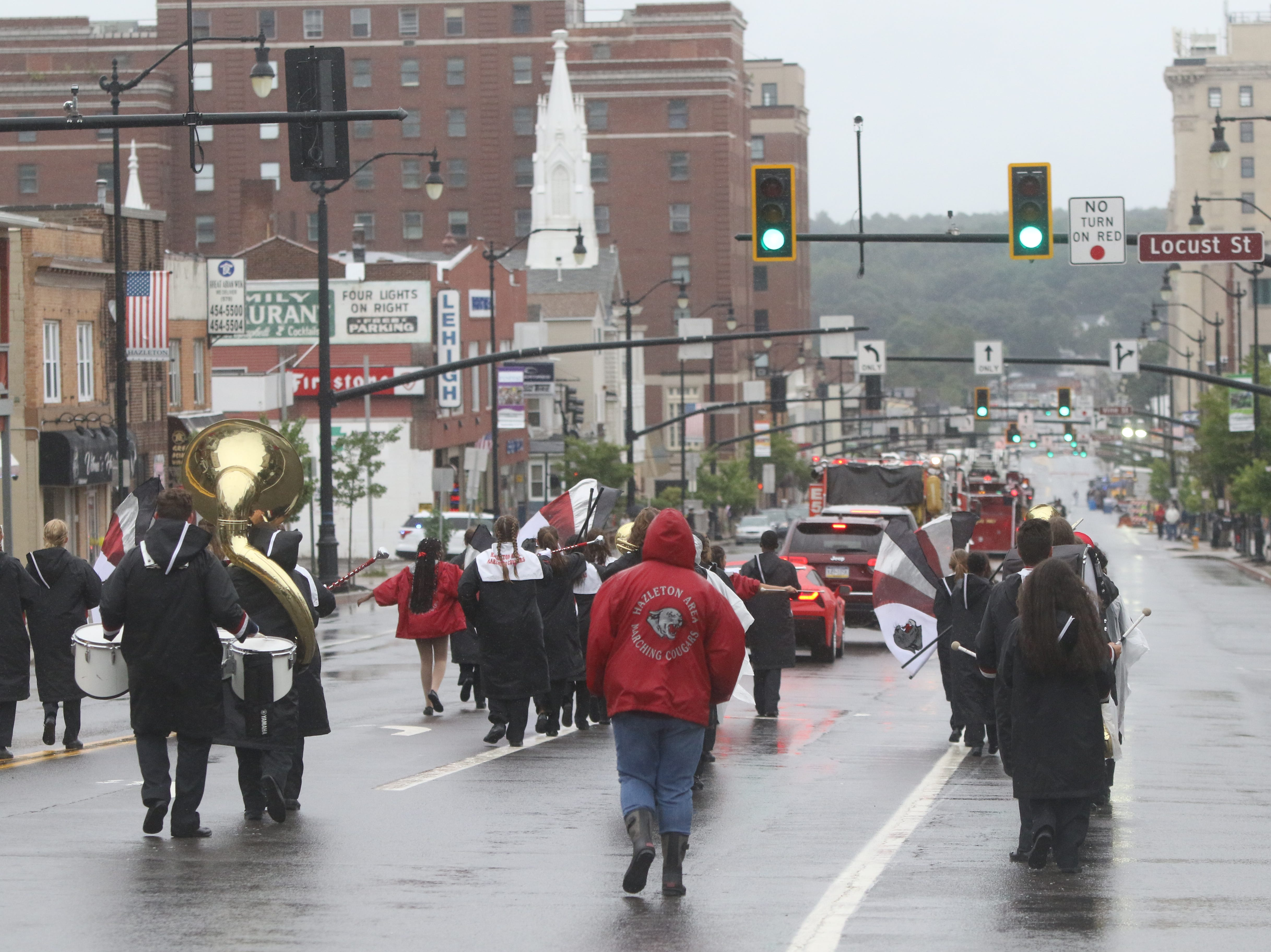 The Hazleton High School marching band make their way along Susquehanna Blvd. as part of the Hazleton Funfest Parade in the rain. Long time Hazleton locals and members of the Hispanic community march through town to celebrate the community of Hazleton.