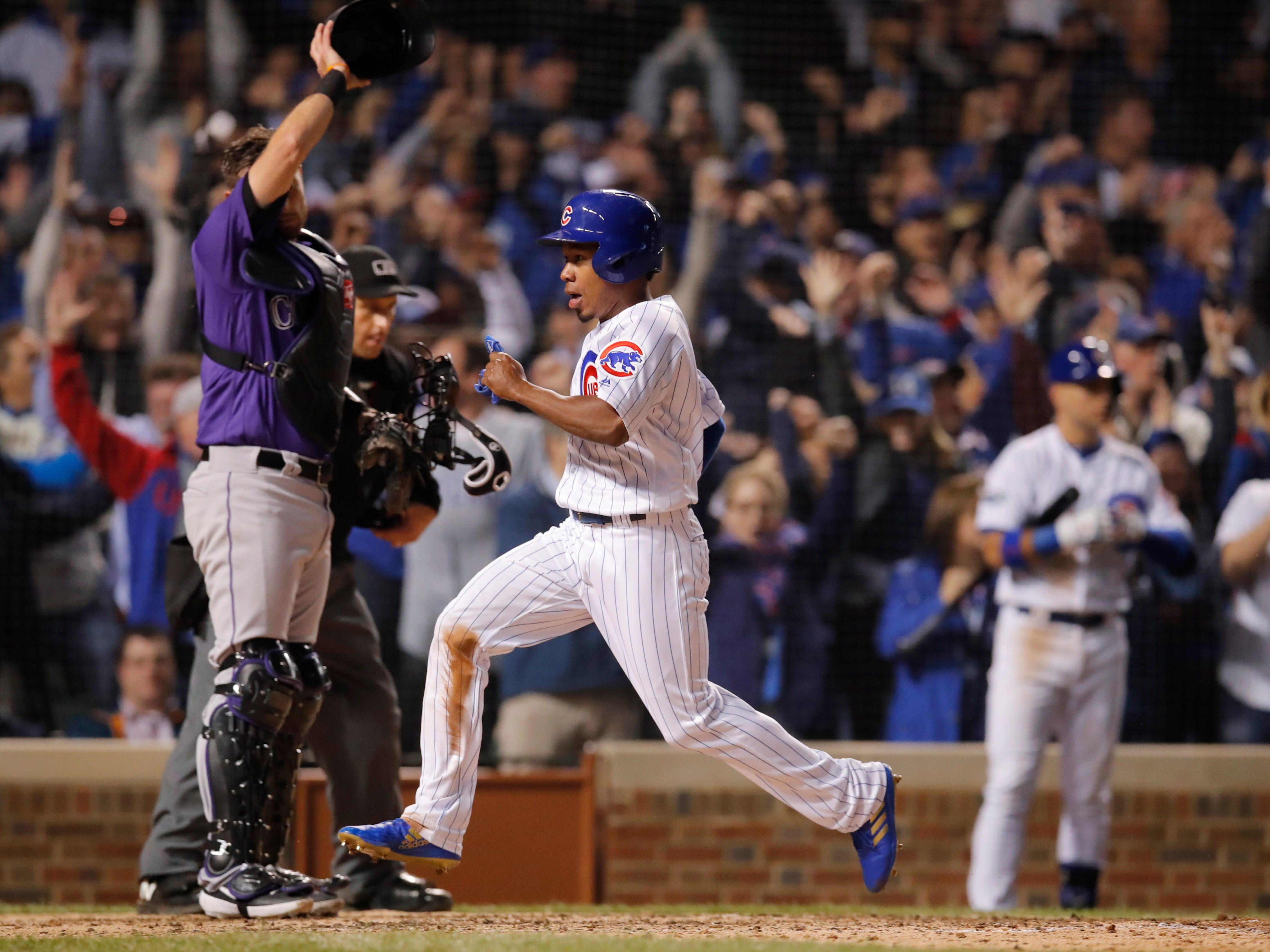Oct 2, 2018; Chicago, IL, USA; Chicago Cubs pinch runner Terrance Gore scores a run against the Colorado Rockies in the 8th inning in the 2018 National League wild card playoff baseball game at Wrigley Field.
