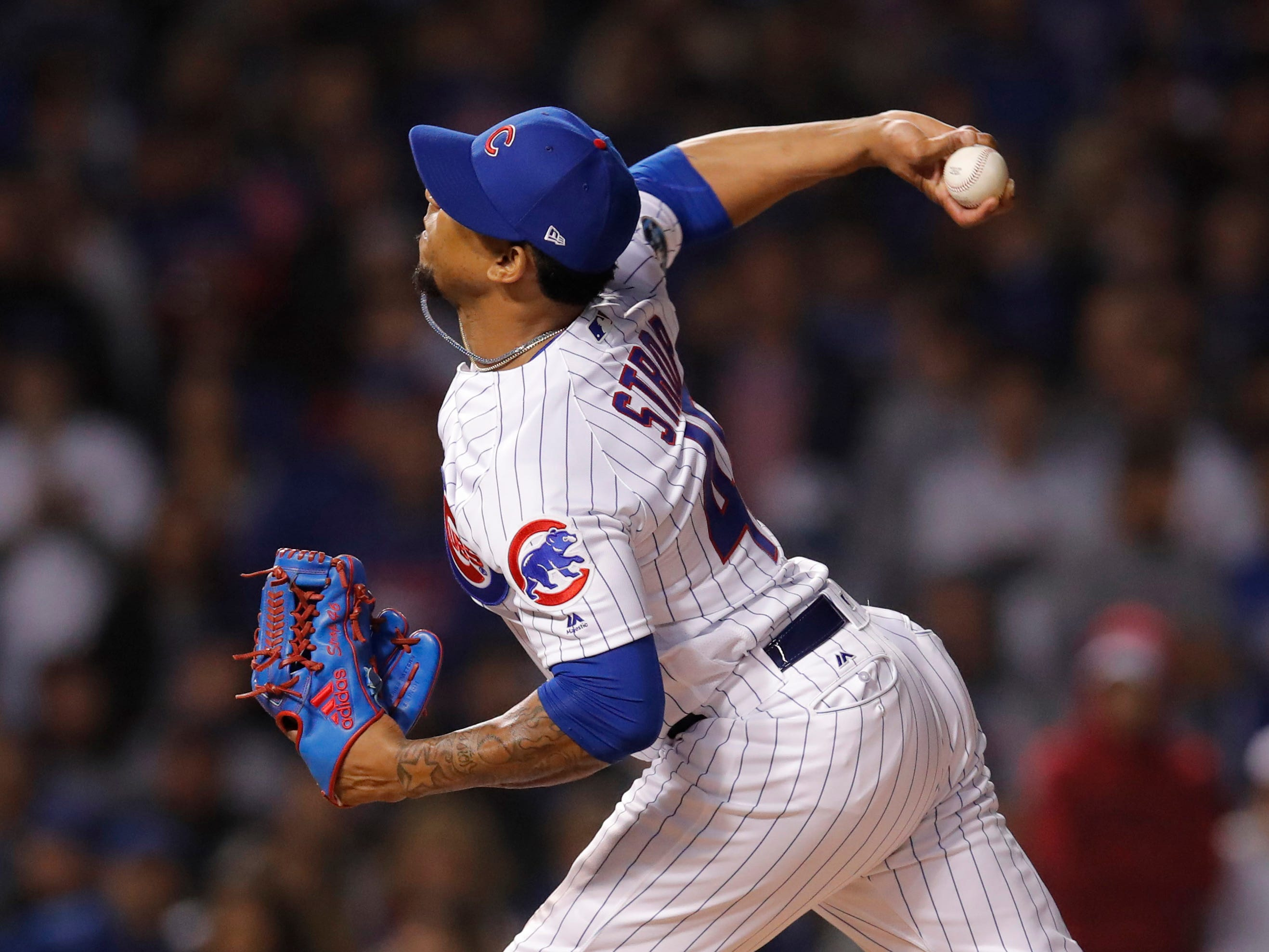 Oct 2, 2018; Chicago, IL, USA; Chicago Cubs relief pitcher Pedro Strop throws a pitch in the 9th inning against the Colorado Rockies in the 2018 National League wild card playoff baseball game at Wrigley Field.
