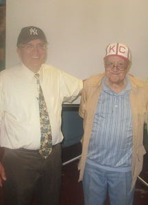 Historian Larry Hogan, left, and former player Jim Robinson during a 2017 visit to Paterson for a program about Negro League baseball.