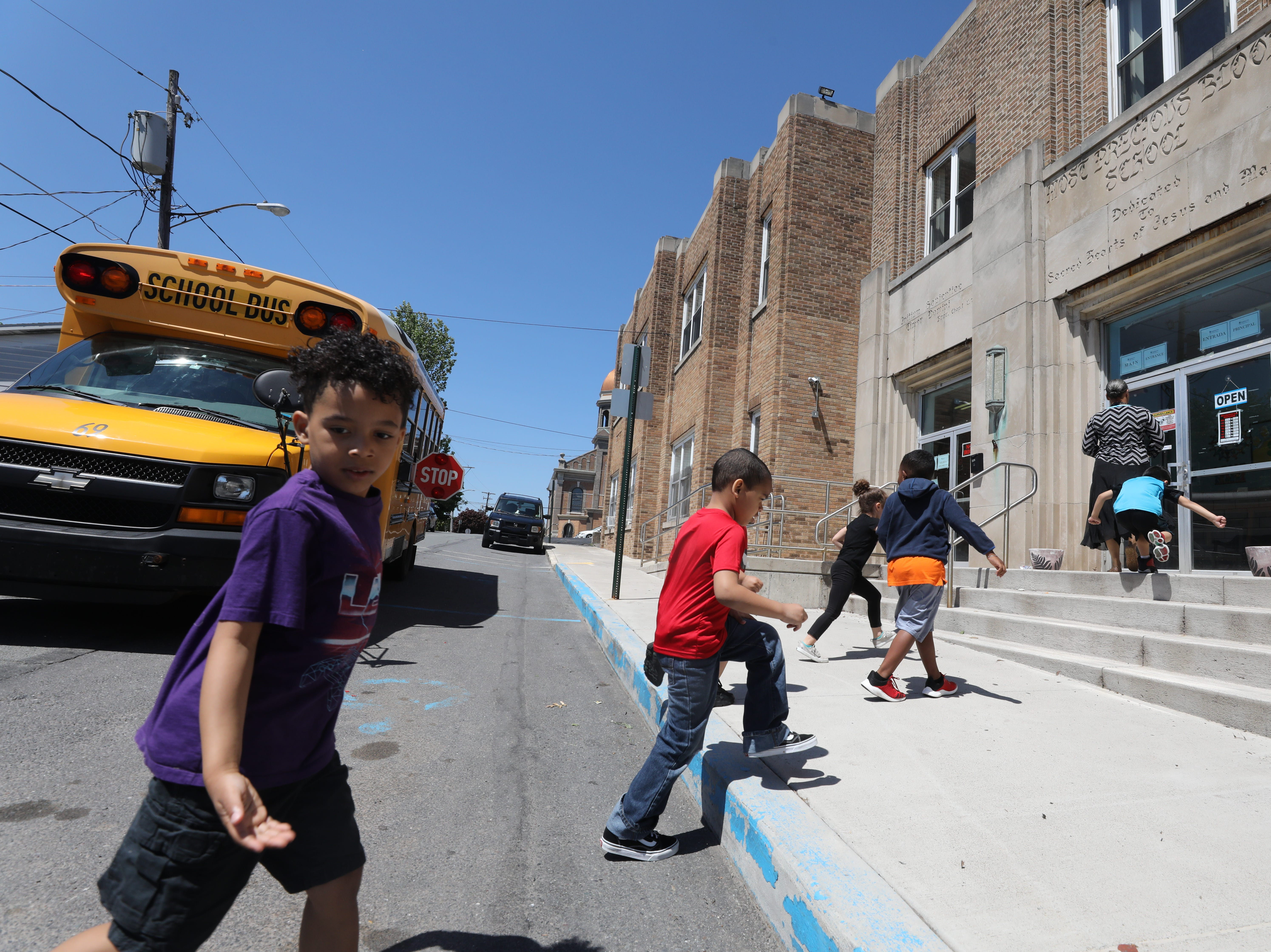 Children are dropped off at a former Catholic school that houses the Hazleton Integration Project.