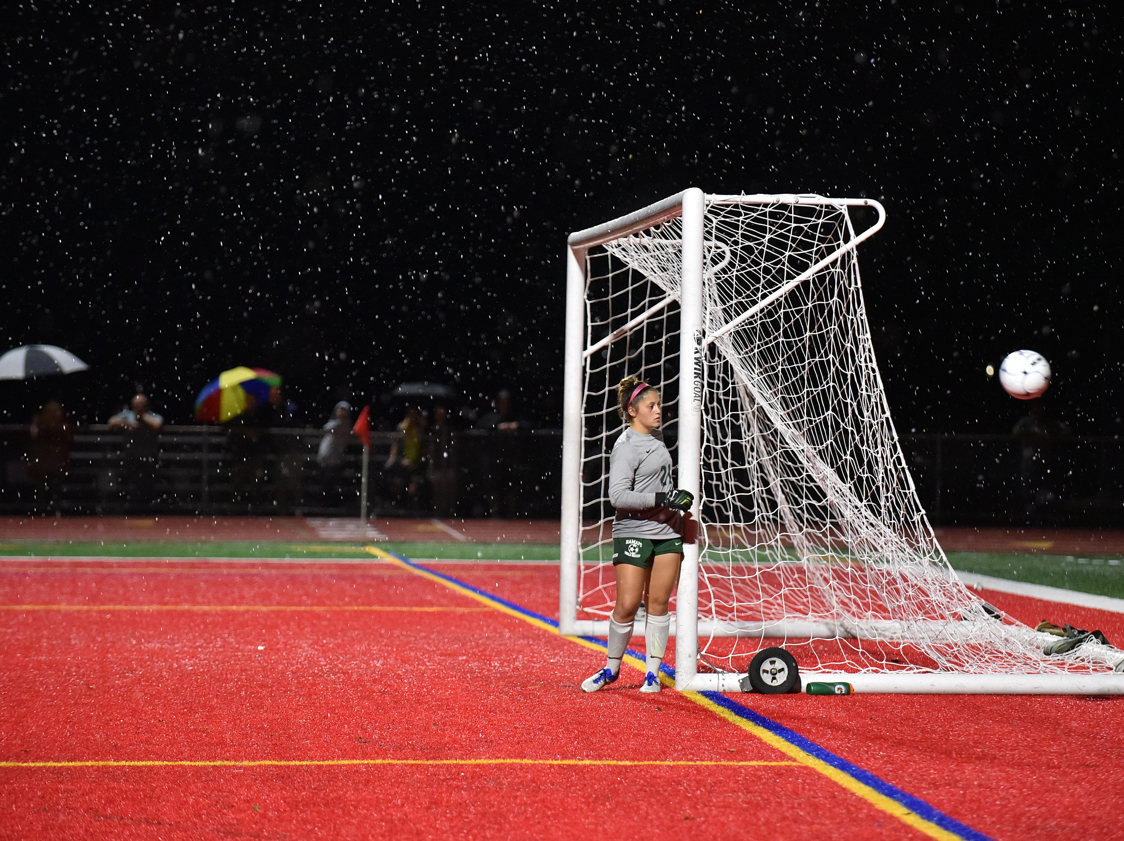 Ramapo goal keeper Natalie Kologrivov waches the ball flying by her net while rain falls at a match versus Northern Highlands.