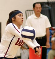 Senior libero Kianna Gomez worked the passing game Tuesday against an aggressive Centennial Hawks varsity at Deming High School.