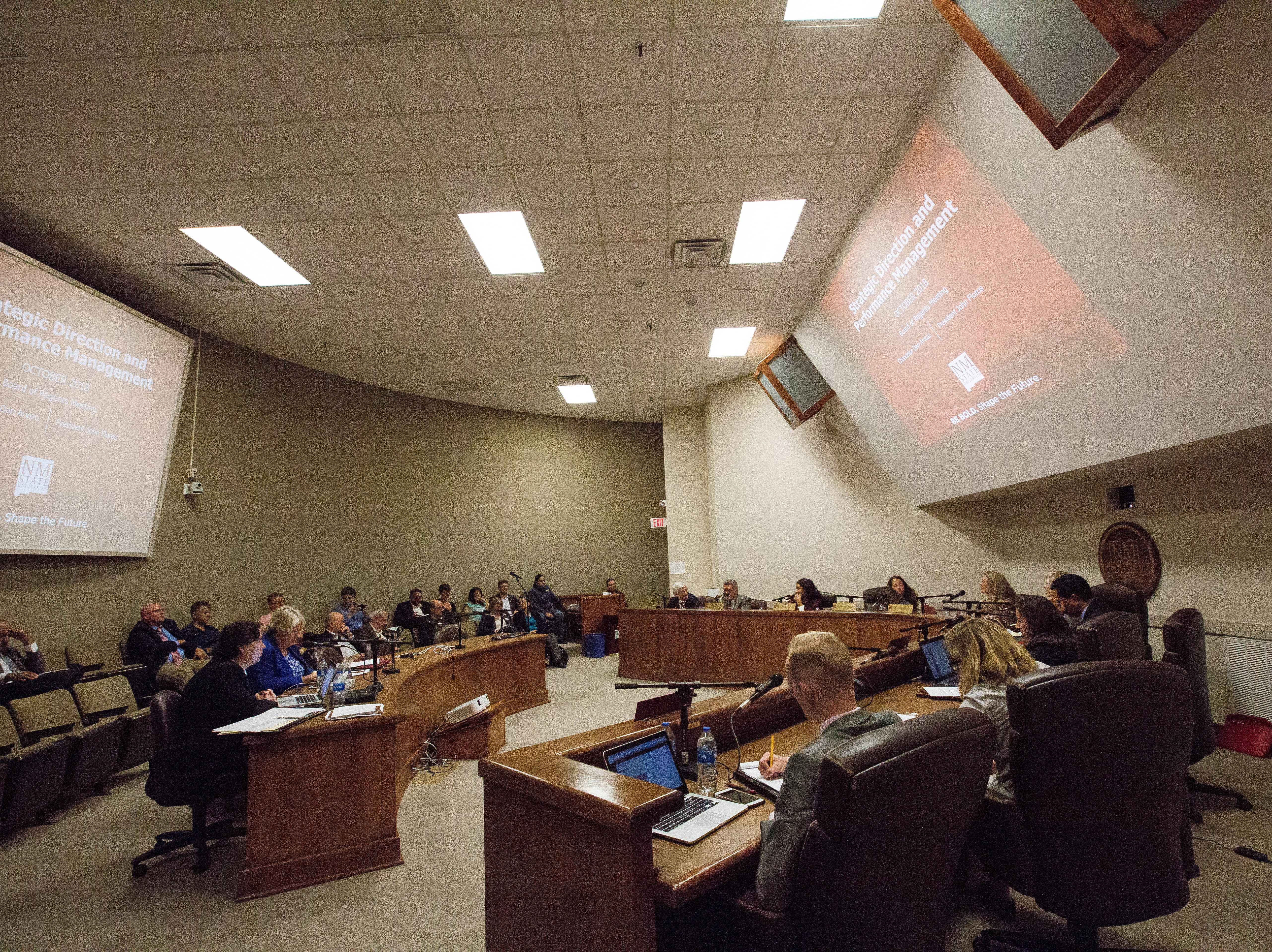 The New Mexico State University Board of Regents look at a presentation of the university's strategic direction and performance management Wednesday October 3, 2018.