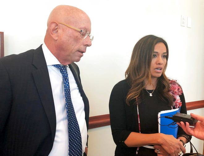 State. Rep. Monica Youngblood, R-Albuquerque, with her attorney Paul Kennedy, speaks to reporters on Tuesday, Sept. 25, 2018, after her trial in a DWI case at a courthouse in Albuquerque, N.M. A judge on Tuesday found Youngblood guilty of aggravated drunken driving, citing her performance and seemingly flippant demeanor during a field sobriety test last spring.