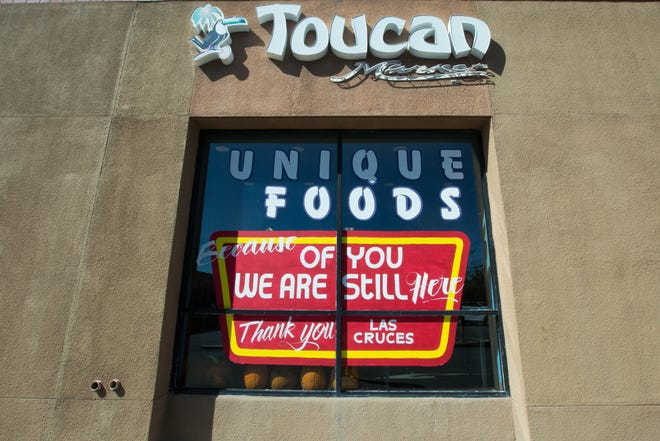 "A sign outside Toucan Market proclaims, ""Because of you, we are here."" Owner Bob Baur said customers showed so much support since the business announced it was closing that Baur was able to secure a loan and stay open."