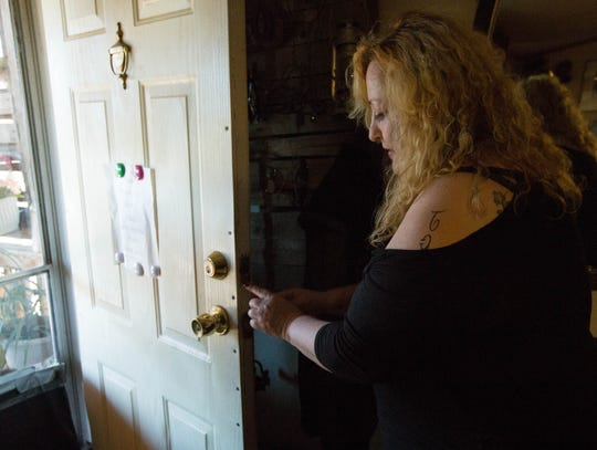 Betty Jo McCowan-Lindsey shows where the deadbolt lock was kicked out of her front door as her attacker entered the house Wednesday Oct. 3, 2018. Lindsey is now part of a domestic survivors support group, helping herself and other women in the area with the trauma caused by a violent attack from a close family member or spouse.